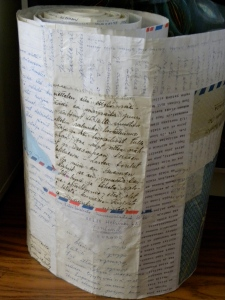 I started with gluing pieces of old family letters from our Finnish relatives onto a roll of rice paper